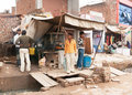Fast food restaurant built over sewer on street market agra india circa february several people in the photo Stock Photography