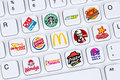 Fast food restaurants like mc donalds burger king kfc starbuc berlin germany april collection of logos of starbucks pizza hut on a Royalty Free Stock Image