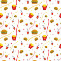 Fast food seamless pattern design with burger chips and soda drinks Stock Images