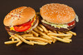 Fast food set big hamburger and french fries on black background Stock Photos