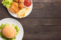 Fast food set fried chicken,french fries and hamburger on wooden Royalty Free Stock Photo