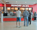 Fast food shop people queue at hungry jacks Royalty Free Stock Photos