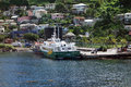 A fast island ferry docking in the caribbean passenger ship at grenadines wharf at st vincent Stock Photo