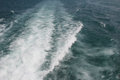 Fast motorboat with splash and wake on an ocean Royalty Free Stock Photo