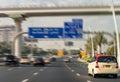 Fast moving Dubai taxi along city main road