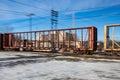 Fast Moving Empty Lumber Car Across Railway Tracks Royalty Free Stock Photo
