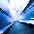 Fast moving escalator Stock Images