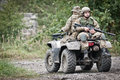 Fast response squad special forces soldiers on all terrain vehicle Royalty Free Stock Images