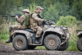 Fast response squad special forces soldiers on all terrain vehicle Stock Photography