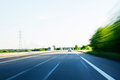 Fast speeding car on highway POV Royalty Free Stock Photo