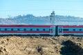 Fast speeding up train in countryside railway