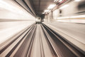 Fast underground train riding in a tunnel of the modern city Royalty Free Stock Photo