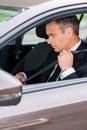 Fastening his seat belt. Royalty Free Stock Photo