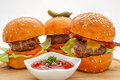 Fastfood - Three hamburgers Royalty Free Stock Photo