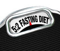 Fasting diet words on scale lose weight the a display to symbolize the new dieting fad or craze where you reduce calorie intake to Royalty Free Stock Photos