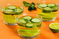 Fat burning detox drink sassy water close up very sliced cucumber lime and mint in the glasses Royalty Free Stock Photos