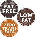 Fat free and trans fats stamps low zero stamp set for food products restaurant menus Stock Images