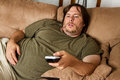 Fat lazy guy on the couch Stock Photo