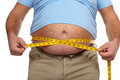 Fat man with a big belly holding measuring tape weight loss Stock Photography