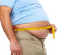 Fat man with a big belly holding measuring tape weight loss Royalty Free Stock Image