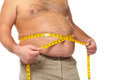 Fat man with a big belly holding measuring tape weight loss Stock Image