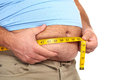 Fat man with a big belly holding measuring tape weight loss Stock Images