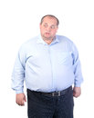 Fat Man in a Blue Shirt, Contorts Antics Royalty Free Stock Image