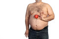Fat man holding apple on a white background Stock Photo