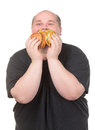 Fat Man Looks Lustfully at a Burger Stock Image
