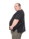 Fat Man Standing in Profile and Holding her Belly Royalty Free Stock Photography