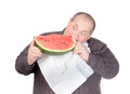 Fat man tucking into watermelon Royalty Free Stock Photos