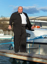 Fat man in tuxedo on deck boat overweight standing the of a luxury pleasure Royalty Free Stock Images