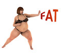 Fat overweight woman fights for weight loss a in fighting karate pose with term front of her as it showing she is fighting Royalty Free Stock Images