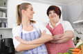 Fat and overweight woman posing in the kitchen two women one slim one healthy eating girl friends have fun Royalty Free Stock Images