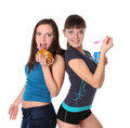 Fat and thin girls is eatting Royalty Free Stock Photos