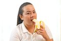 Fat woman with banana asian on white Stock Photos