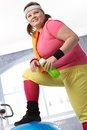 Fat woman in colorful sportswear Royalty Free Stock Photography