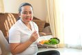 Fat woman eating salad
