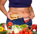 Fat woman with hamburger and vegetables a Royalty Free Stock Images