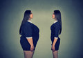 Fat woman looking at slim girl. Diet choice concept Royalty Free Stock Photo