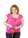 Fat   woman measuring waist Royalty Free Stock Image