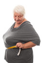 Fat woman measuring waist isolated over white background Stock Photography