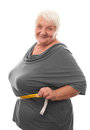 Fat woman measuring waist isolated over white background Stock Images