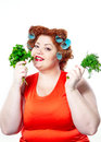 Fat Woman With Sensuality Red Lipstick In Curlers On A Diet Holding Parsley And Dill