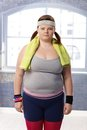 Fat woman in sportswear Stock Image