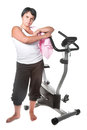 Fat woman workout on the bicycle Stock Photo