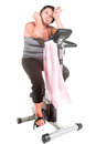 Fat woman workout on the bicycle Stock Image