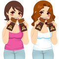 Fat women eating chocolate guilt two two bars each like there is no tomorrow with expression Royalty Free Stock Photos