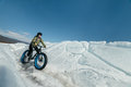 Fatbike x fat bike or fat tire bike x also called cycling on large wheels extreme girl sitting on the on snow melted ice the Stock Photos