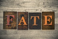 Fate wooden letterpress theme the word written in vintage ink stained type on a wood grained background Stock Images